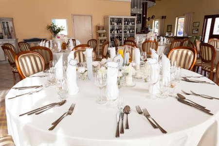 Mediterranean interior - an elegant white table service photo