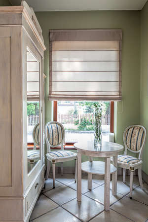mediterranean interior: Mediterranean interior - a stylish corner with a closet, a table and chairs Stock Photo