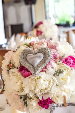Mediterranean interior - a flower bouquet with a heart ornament photo
