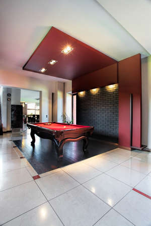 billiards hall: An elegant black and red hall with a pool table Stock Photo