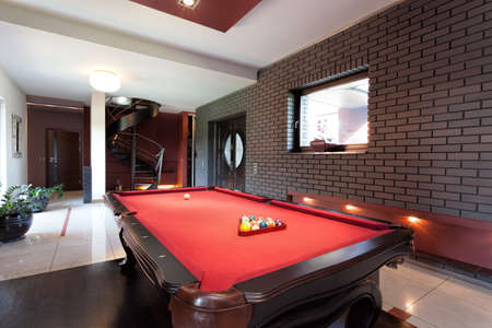 billiards tables: A big red pool table in a luxurious interior