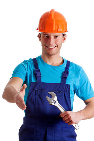Smiled handy man giving a hand to wlecome