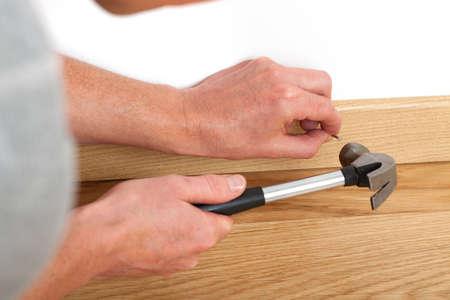 skirting: Handyman repairing a skirting board on the floor
