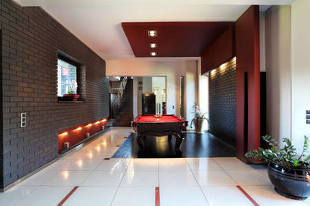 basement: Modern interior with billiard table in living room