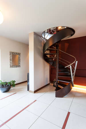 Black original spiral stairs in a fair classy room photo