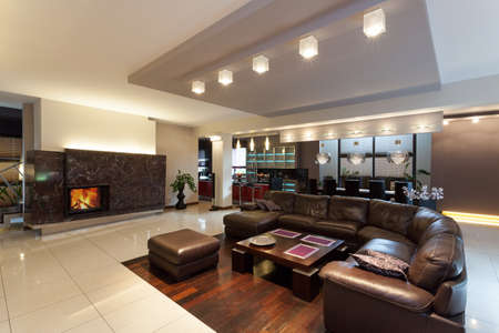 Spacious living room with couch in modern house photo