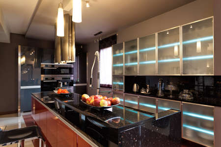 home  lighting: A luxurious kitchen wth a modern cooking island
