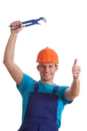 locksmith: A happy builder in an orange helmet holding a spanner Stock Photo