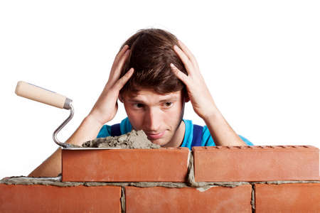 Man having a problem with building a wall photo