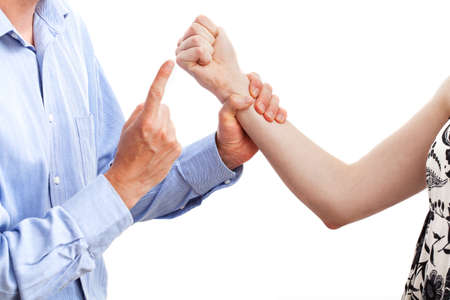 submission: A man warning a woman threatening him with her fist Stock Photo