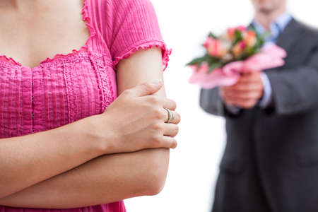 A close up of a woman with a man behind her striving with flowers photo
