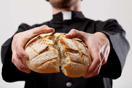 Symbol of Communion breaking loaf of bread photo