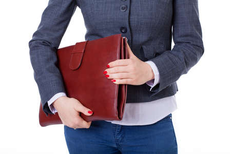business case: Young active businesswoman standing with briefcase