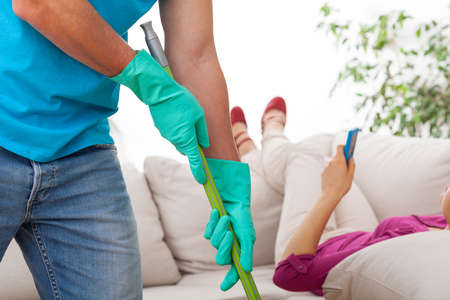 Adult man helping at home with cleaning photo