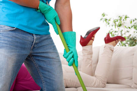 brooming: Husband working in house while his wife resting in sofa