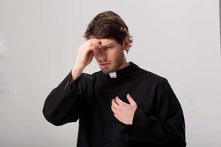 begining: Priest wearing a soutane begining his prayer
