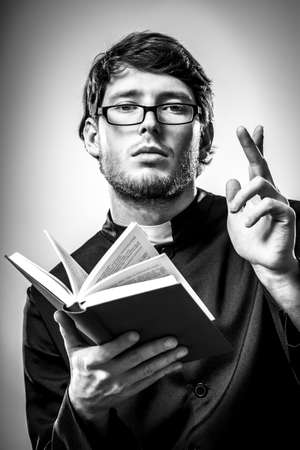 lecturing: Cleric person is lecturing Holy Scripture from Bible to believers