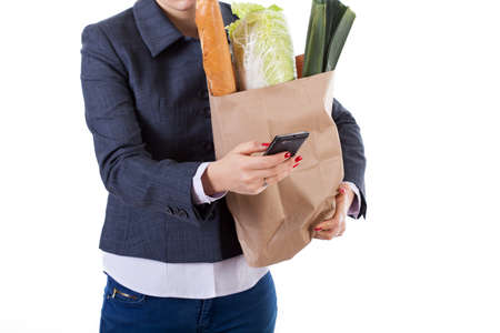 hectic: Active woman at work calling and keeping bag with home shopping