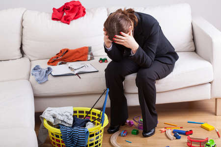 Woman who work and care of house is exhausted and stressed of her workload Stok Fotoğraf