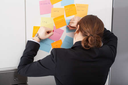 Woman is exhausted of morning list of daily tasks photo
