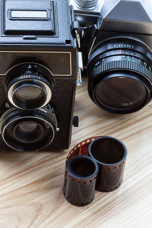 An old twin-lens camera and a modern reflex camera photo