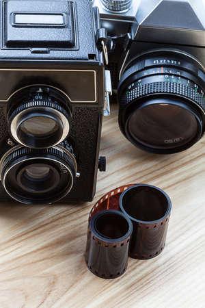 darkroom: An old twin-lens camera and a modern reflex camera