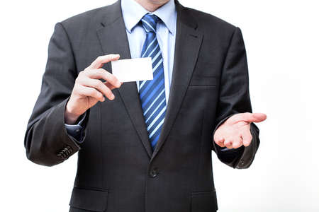 Man in suit holding a business card, isolated photo