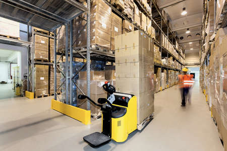 warehouse cargo: Forklift with products in a warehouse