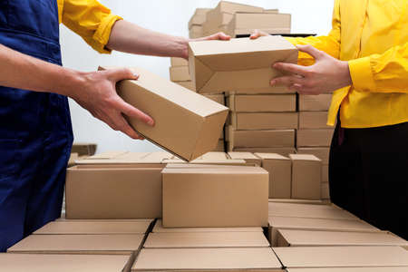 packing tape: Workers in parcel delivery company preparing a deliver