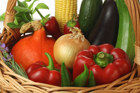 fruitage: Basket full of colourful vegetables and flowers Stock Photo