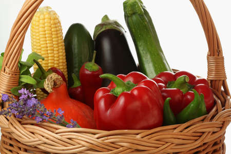 dietetical: Basket with the greens and violet flowers Stock Photo
