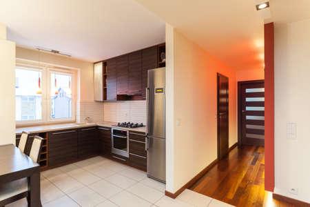 Spacious apartment - interior of kitchen and corridor photo