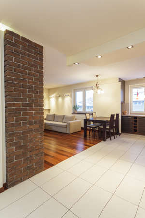 Spacious apartment - living room with brick wall photo