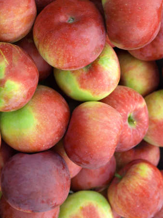 dietetical: Vertical close up of pile of apples Stock Photo