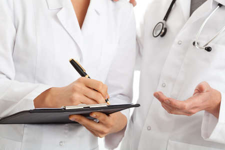 Two doctors conversing about chosen medical treatment photo