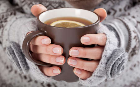 Closeup of a hands with hot drink photo