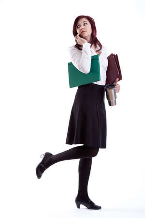 Businesswoman going to work with papers and mug. photo