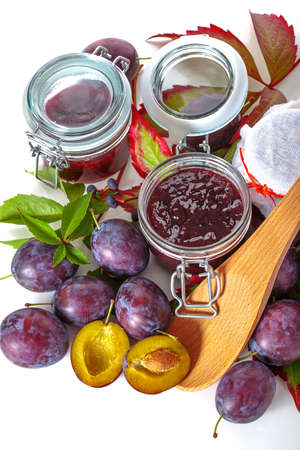 Preparing the jars with jams from autumn fruits photo