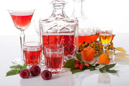 Set of traditional homemade liqueurs in carafes