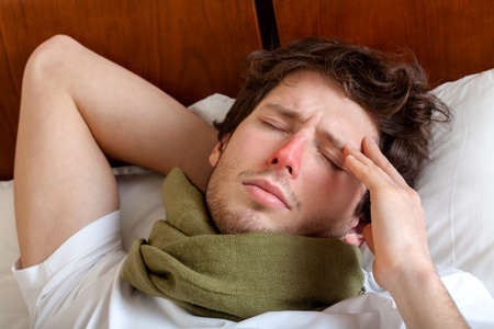 Man lying in bed with a flu photo