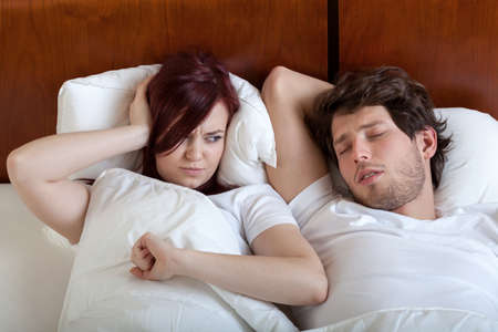 Woman cant sleep because of her boyfriend snoring photo