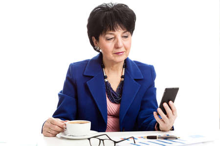 Modern elderly with smartphone on business meeting photo