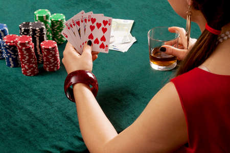 A poker player holding a stright flush of hearts photo