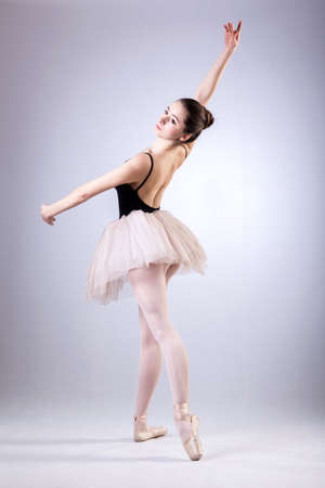 Beautiful dancer during ballet training in pointes photo