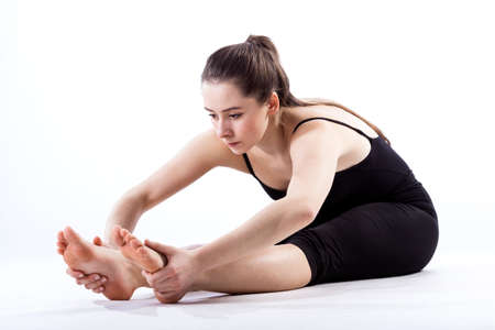 Young ballet dancer training hard her fexibility photo