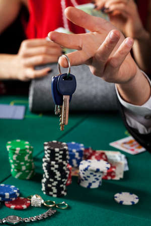 A closeup of car keys above a gambling table photo