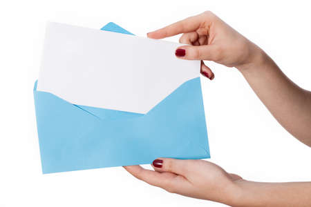 hand craft: Womens hand holding blue envelope and card for your own text there Stock Photo
