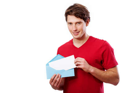 your text here: Young man in red t-shirt holding blue envelope for your text here Stock Photo