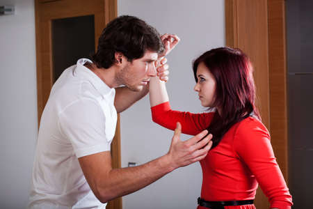 Man using violence to his wife at home photo