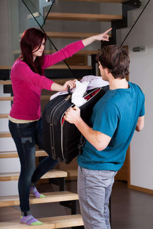 Angry woman throwing man away from home using violence Stock Photo - 25624874